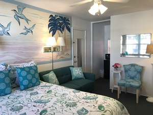 Rm #16 - Updated in JAN 2019! 1 Brand NEW Pillow-top Queen Bed. New Furniture. Colorful Ocean Mural. 2nd floor. Street/Parking View. Picture 1